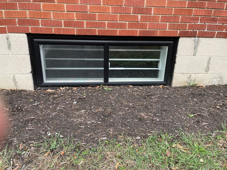 Residential basement window security bars