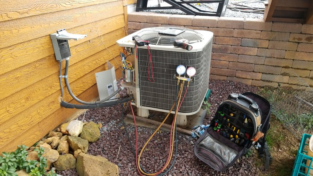 Perform heating inspection on Payne heat pump system. Cleaned system and checked refrigerant pressures.