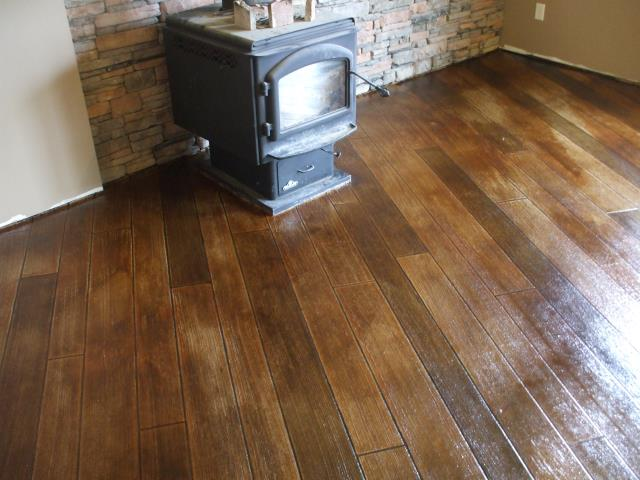 Las Vegas, NV - I love this wood floor! All the different shades and details in each individual plank really makes the floor come to life and awe the eye when entering the room! Las Vegas Concrete Decor knows how to make a floor the exact shade that you want it to be so that everything in the room compliments each other!
