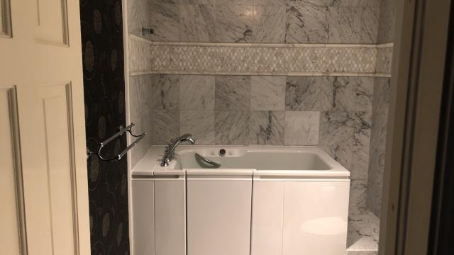 Denver, CO - Installed a beautiful Kohler Walk-In Bath that goes great with the tile in the bathroom.