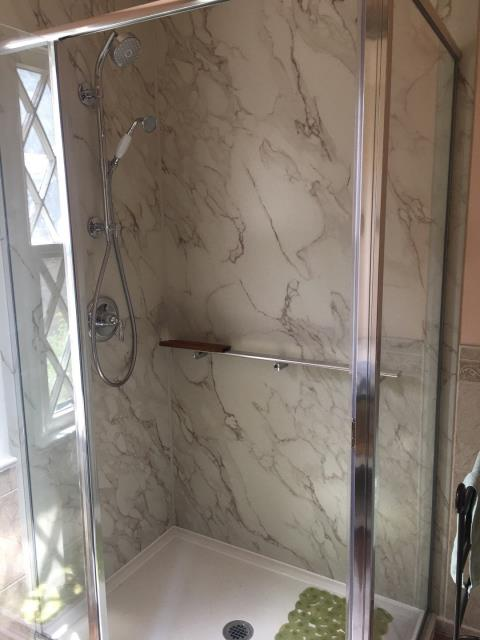 Fort Collins, CO - After photo of Kohler Shower System install with floating shelf