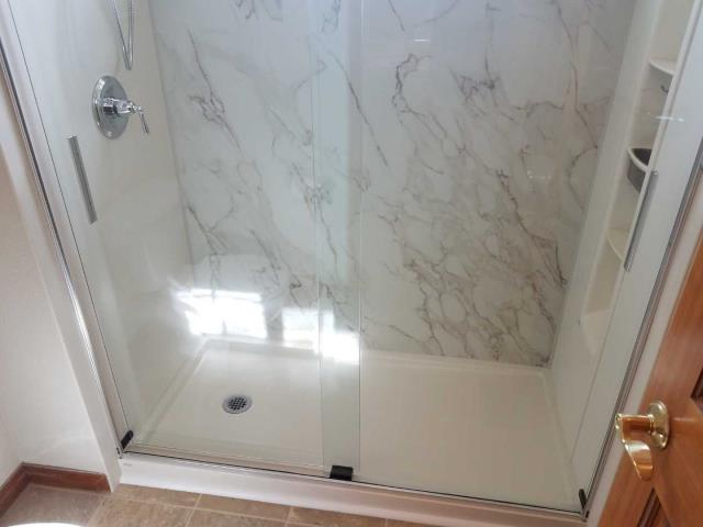 Thornton, CO - After photo of brand new Crosscut Dune Kohler Shower System with shower locker