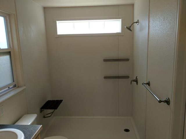 Fort Collins, CO - After photo of tub/shower combo, now a brand new Kohler Shower System in white with brush nickel floating shelves, fixtures and teak fold down seat!!
