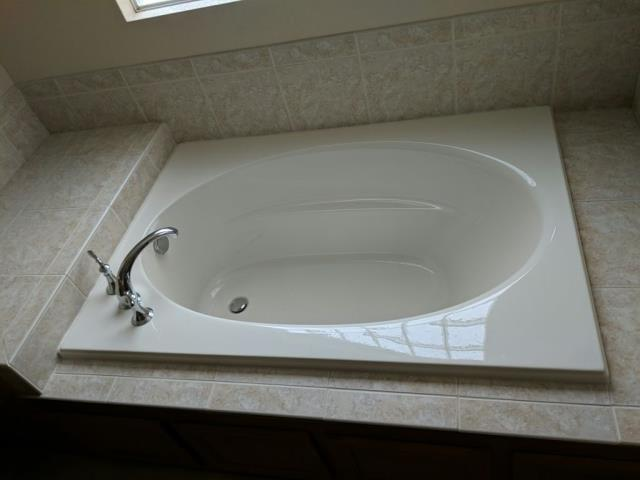 Littleton, CO - Removed an old jetted tub and installed a new Kohler bathtub.