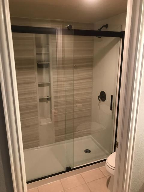 Larkspur, CO - Just completed a shower transformation from an outdated bathtub to a LuxStone shower. Our happy customers love the LuxStone shower walls as they provide the durability and beauty of stone, with easy cleaning and maintenance. No more hard to clean grout and tile!!
