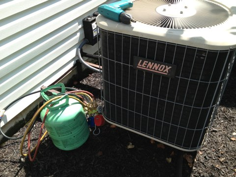 O'Fallon, MO - Refilled r22 freon on 2.5 ton Lennox air conditioner. Clean and check.