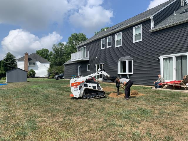 Newtown, PA - Starting concrete footings for a custom Timbertech deck with Radiance Railing with a covered deck in Newtown Pa.