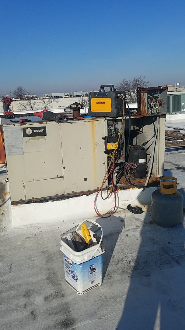 Garden City, NY - Recovering refrigerant and disconnecting electric for replacement of this rooftop unit tomorrow
