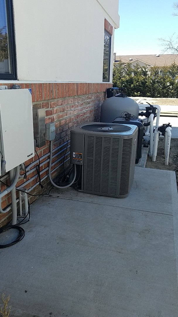 Massapequa, NY - Reinstalling a condenser after work done on pool extended pipes installed new line dryer and evacuated system and recharged to proper refrigerant levels