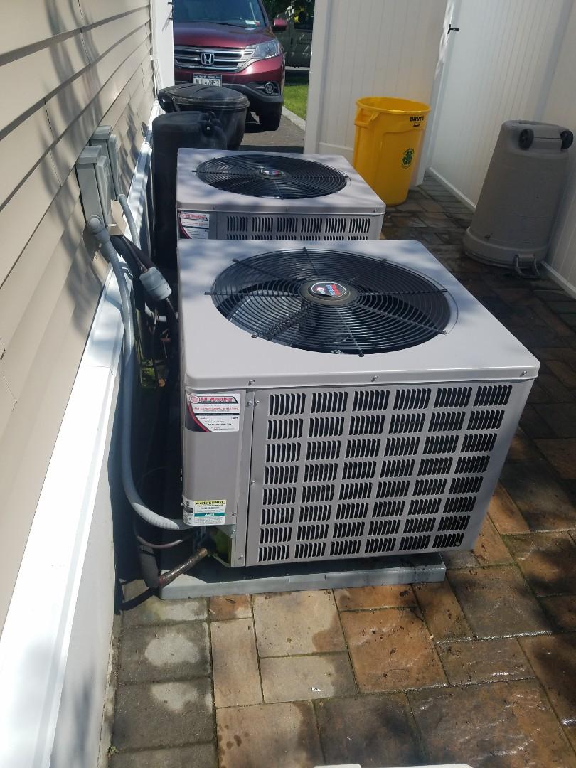 Massapequa, NY - Desimone Preventive maintenance on 2 central Iraq conditioning units Massapequa ny