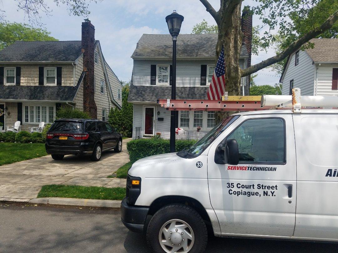 Garden City, NY - RHEEM Air Conditioning Maintenance inspection Garden City