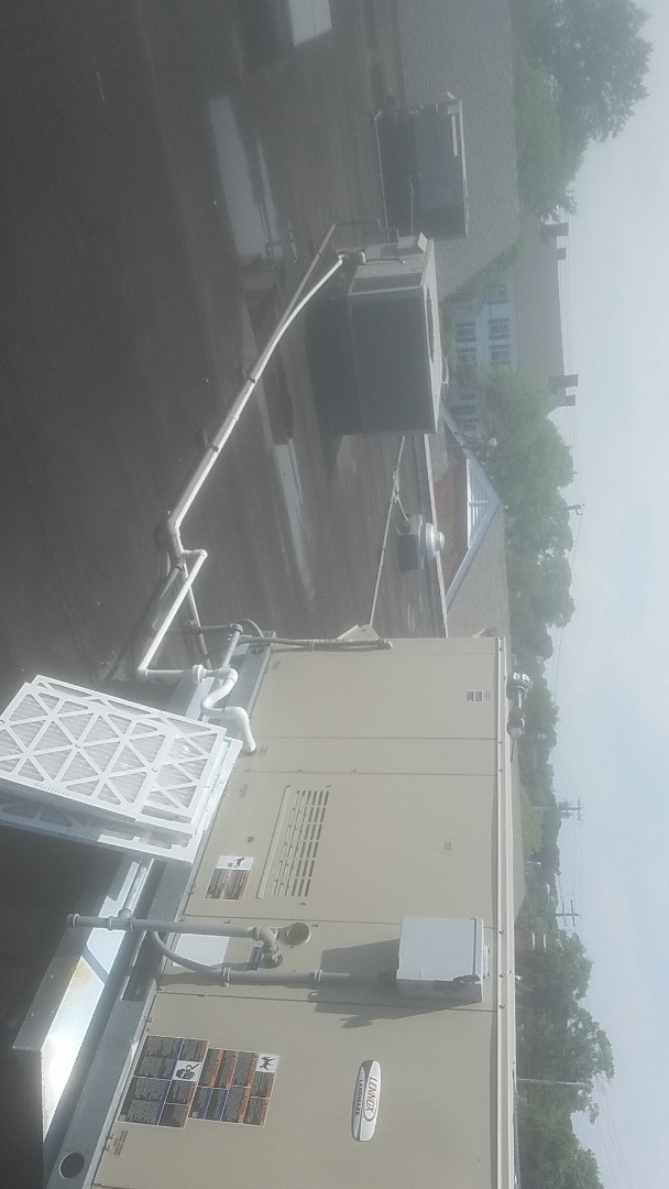 Babylon, NY - at argyle sqr babylon village. performing  ac pm on rooftop units