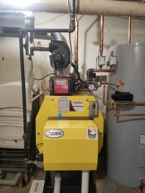 Finished Installation of Energy Kinetics High Efficiency Gas Boiler and hot water storage tank for the Justic Family in Lawrence.