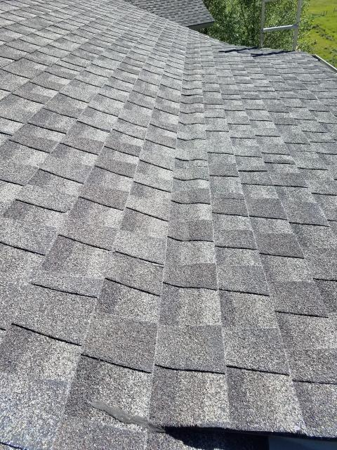 Repair work.  Removed shingles and diverter flashing off lower shed roof and installed new ice and water shield and new shingles.  Installed new gutters and heat cable.