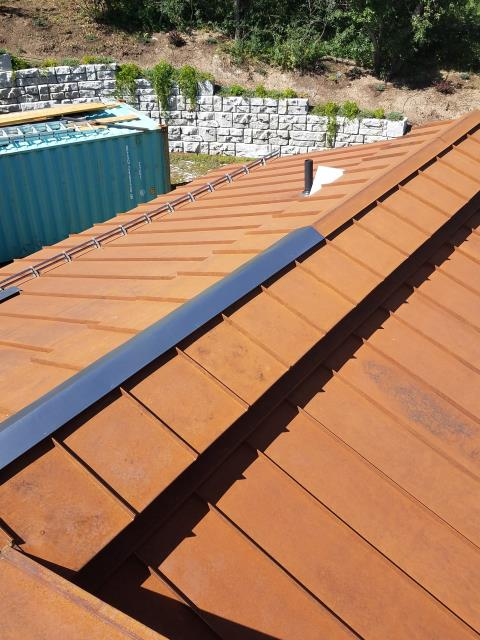 manufacture and install roll formed seamless copper gutter with 220 volt self regulating heat cable and TRA clamp on snow fence.