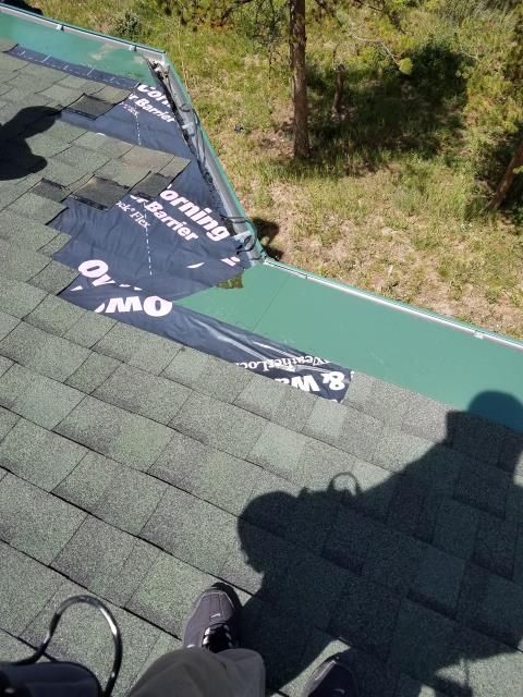 Removed heat cable, existing shingles to install new ice and water shield, new shingles and reinstalled gutter.