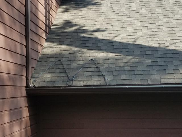 """Installed 5"""" K style roll formed seamless gutter with Raychem self regulating 220 volt heat cable."""