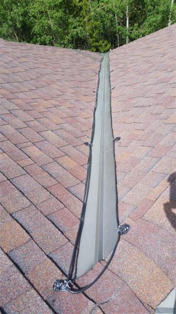 Install Raychem self regulating heat cable and flashing repair.