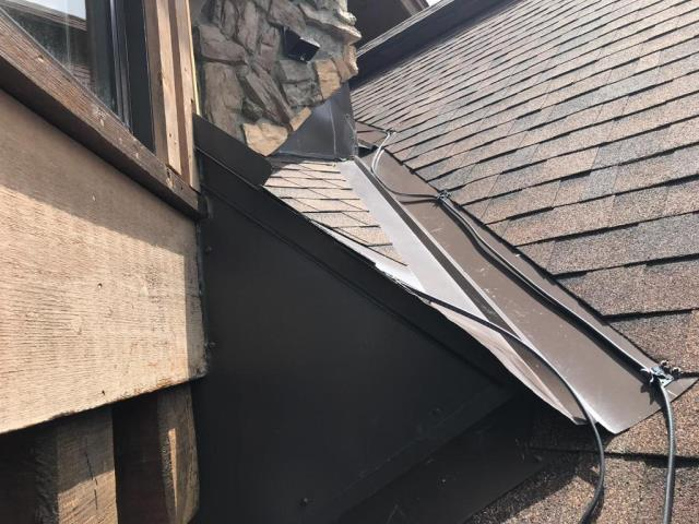 Install Roof Sealant to Cap/Stone Juncture to Try Seal From Leaks. Install gutter at Roof Edge Below Chimney and Cricket area. Splice in an Additional 32 ft of 220 Volt Heat Cable