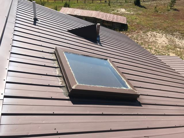 "Clean dust and debris around skylights, Apply Inland Coating ""Skylight Coating"""