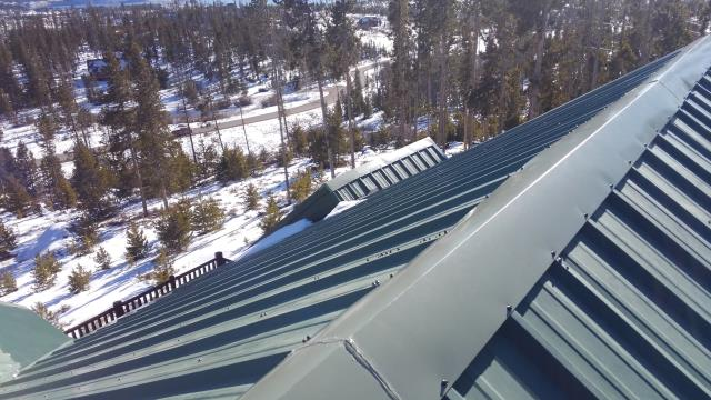 Metal Roof needed a bit of TLC. Fabricated a larger ridge cap, installed snow gems and new pipe jack flashings .