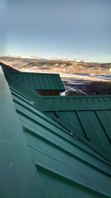 Installed Zephyr roll ridge vent under metal ridge to keep critters out and vent his ridge.