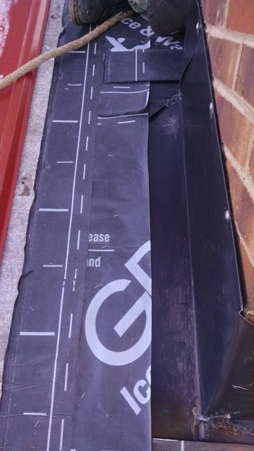 Fixed leaking chimney.  Removed existing metal roofing, installed new Grace ice and water shield, reinstalled metal roofing with new custom fabricated chimney flashings.  Say bye bye to your leak :).