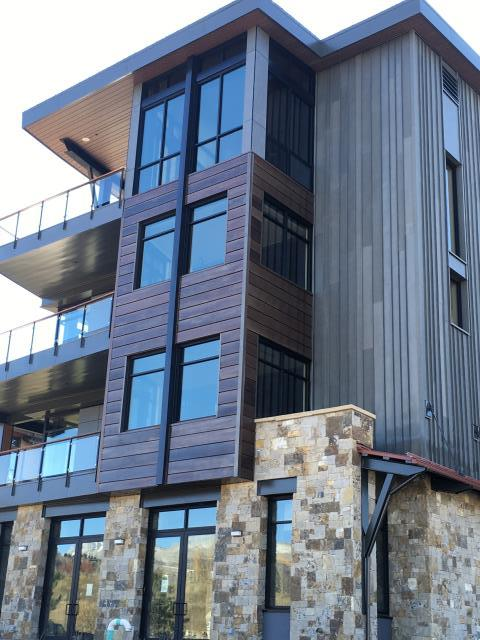 New Construction.  Custom patina metal wall panels fabricated and installed by The Roofing Company (TRC).