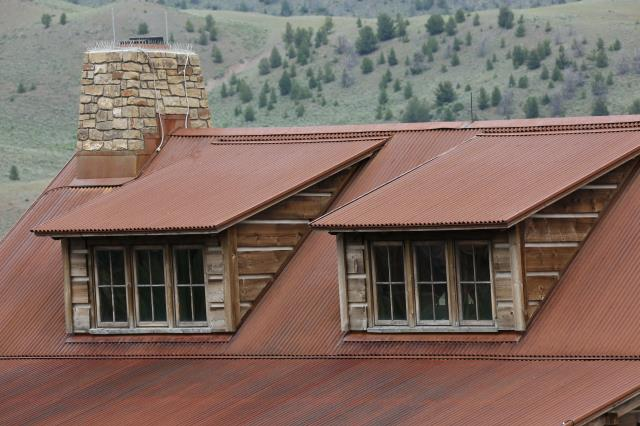 New Construction.  Pre rusted corrugated metal roof panels with custom fabricated flashings fabricated and installed by The Roofing Company (TRC).