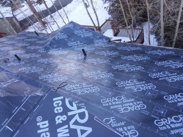 Reroof.  Installed Grace Ice and Water shield, GAF Timberline HD Shingles, Custom 24 gauge metal flashings and drip edge fabricated by The Roofing Company (TRC).  Complete with a GAF 50 year warranty.