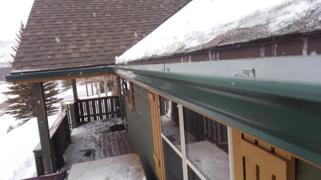 """Installed new seamless rolled formed 5"""" K style steel gutters and Raychem self regulating heat cable through gutter and downspouts to prevent ice build up."""