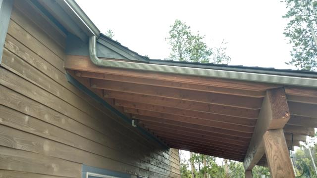 "Installed custom length 5"" K style seamless steel gutter and downspouts and cleaned out existing gutters."