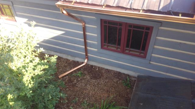 Installed copper gutter and self regulating heat cable