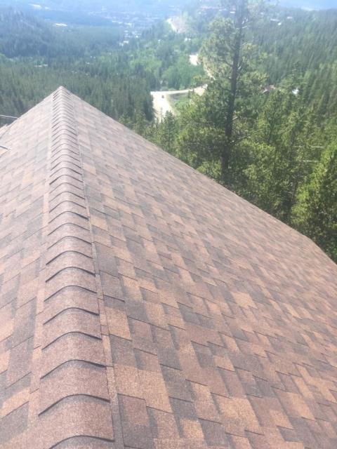 Reroof.   install Owens Corning Weatherlock Flex ice and water shield to 100% of roof surface, Manufactured and install custom 24 Gauge factory painted steel flashings,  installed Owens Corning Tru Definition shingles