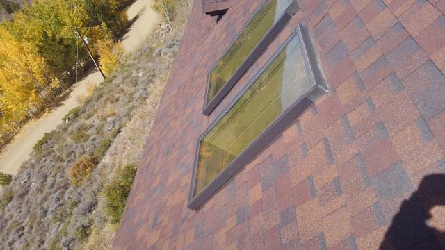 Replaced flashing around skylights.