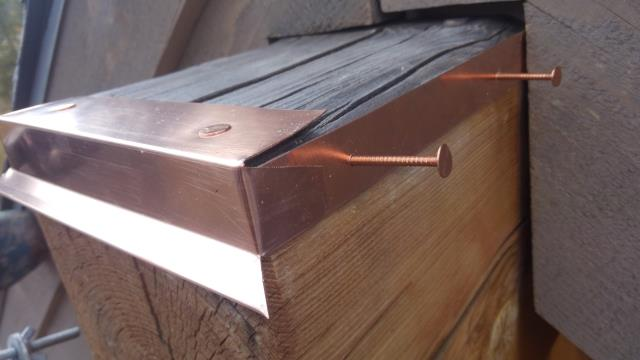 Custom fabricated beam caps from 16oz copper metal.