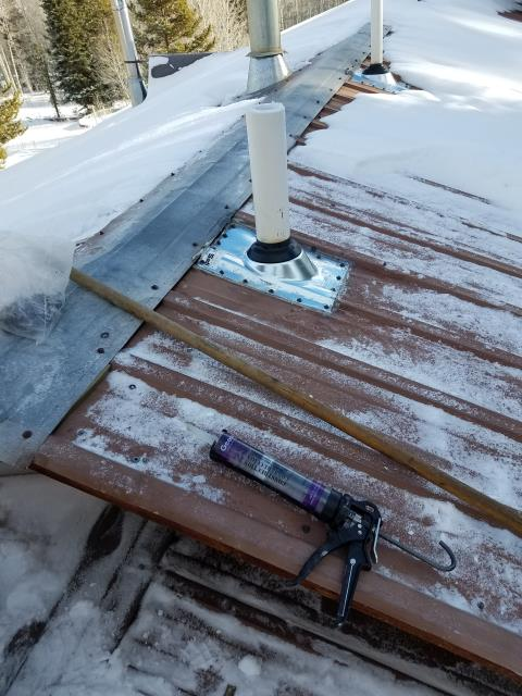 Leaking roof.  Tighten all screws on metal exposed fastener roof.  Removed  broken pipe jacks and replaced.  Manufactured and installed new metal cricket, and caulked skylights and roof tie-in.