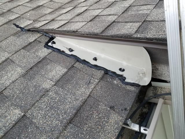 need roof repairs.  Cleaned all gutter and  caulked all seams.  Installed kickout flashings at roof corners where needed to help drain water to gutters.  Nailed down popped up nails.