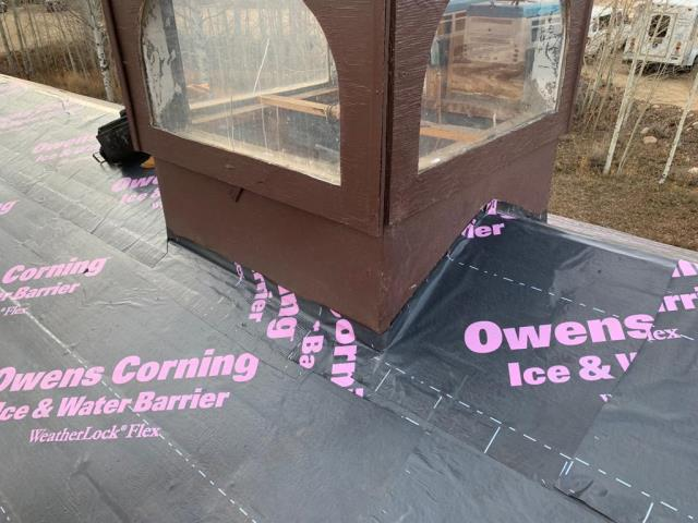 reroof.   Installed Owens Corning Weatherlock Flex ice and water shield to 100% of roof surface, Manufactured and installed custom 24 Gauge factory painted steel flashings, installed Tamko Heritage shingles, installed Owens Corning VentSure ridge vent.