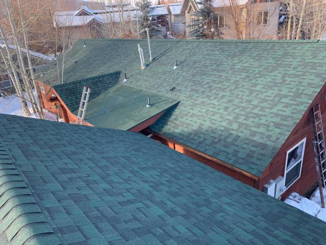 Reroof.   Installed Owens Corning Weatherlock Flex ice and water shield to 100% of roof surface, Manufactured and installed custom 24 Gauge factory painted steel flashings,  installed Owens Corning Tru Definition shingles