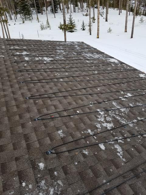 Removed existing damaged heatcable from gutters, downspouts and roof.  installed Raychem self regulating heatcable throughout gutters, downspouts and on roof.