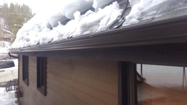 "Installed custom length 5"" K style seamless steel gutter and downspouts with self-regulating heat cable"
