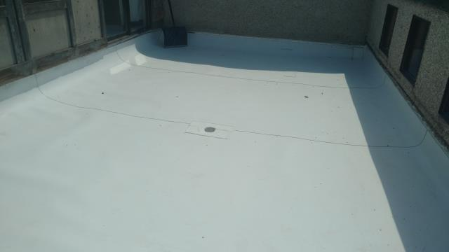 Cottonwood Heights, UT - Finished TPO roof ready for the new deck to be installed.