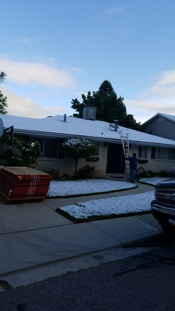 Salt Lake City, UT - Two layer tear off. Little snow removal needed. GAF Timberline roof, gutters, soffit, and fascia.