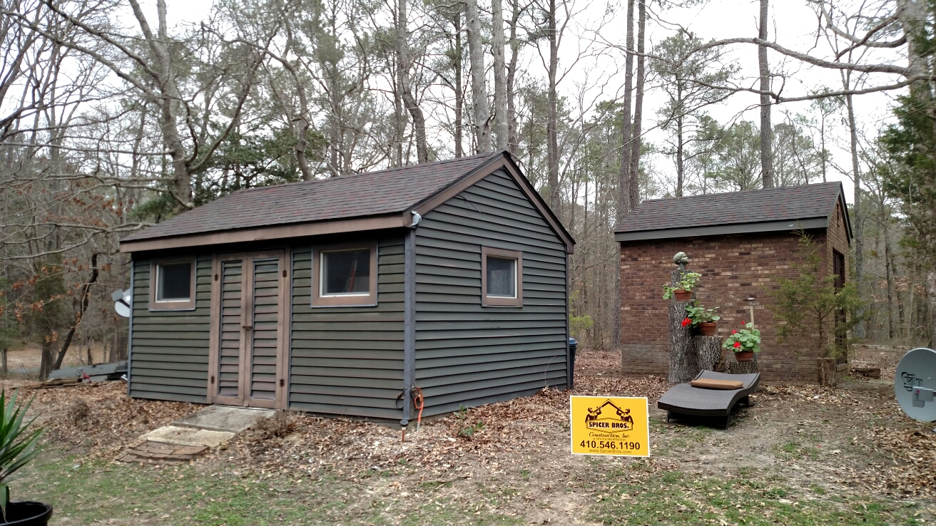 Eden, MD - Spicer Bros Construction removed the old shingles and installed new shingles on these two shed buildings in Eden Maryland using GAF American Harvest shingles the color is midnight blush
