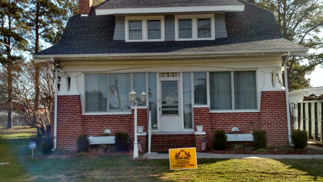 Crisfield, MD - Spicer Bros Construction removed two old layers of shingles from this roof in Crisfield Maryland ,and install new plywood on the entire roof ,and installed new GAF Timberline shingles the color is pewter Gray