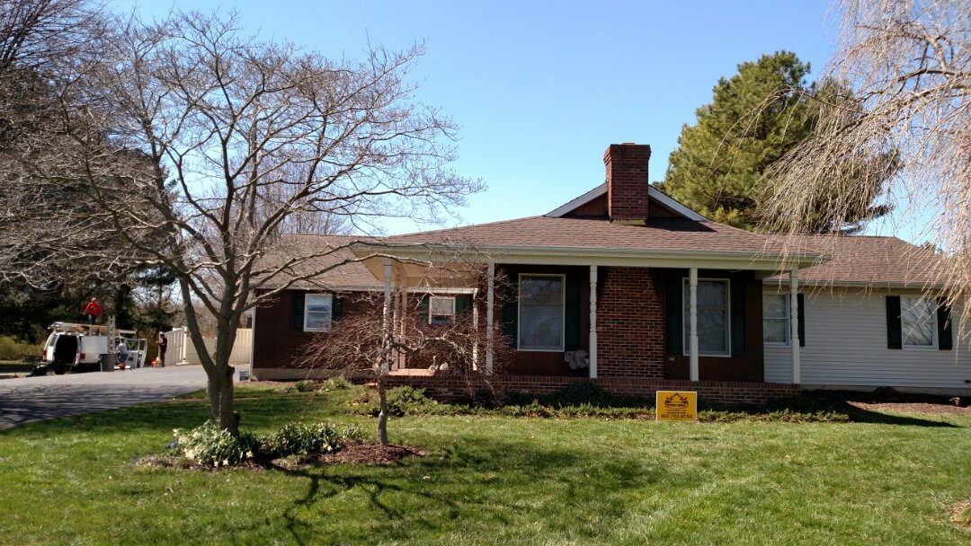 Smyrna, DE - Spicer Brothers Construction remove the old shingles from this roof in Smyrna Delaware and install new GAF Timberline shingles the color is Hickory