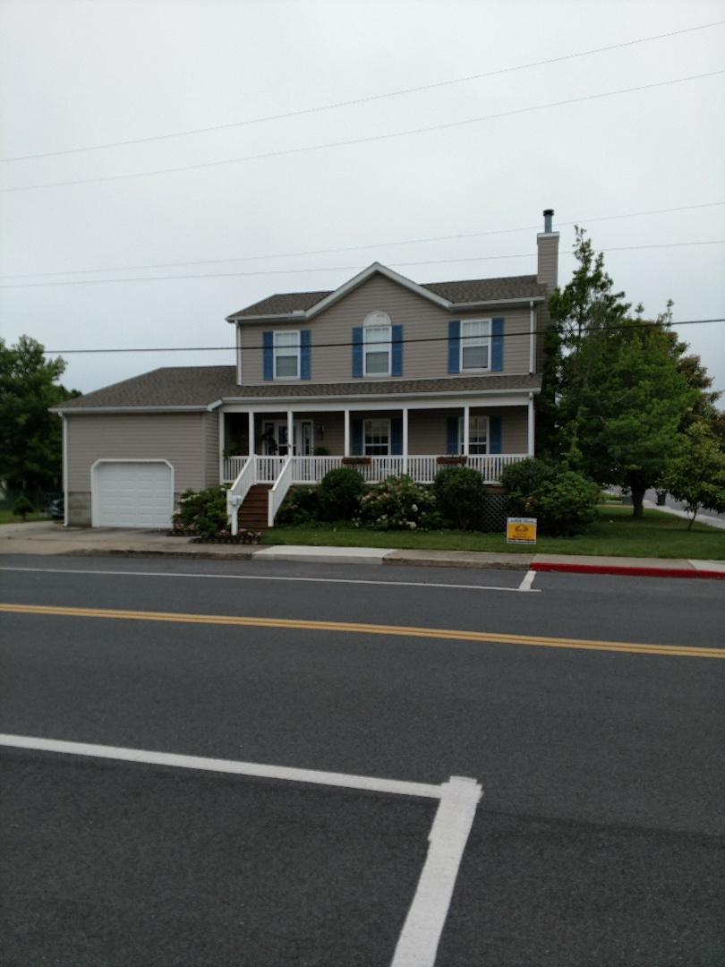Ocean City, MD - Spicer Bros Construction removed one layer of shingles in Ocean City MD and installed new GAF Timberline American Harvest Cedar Falls in color