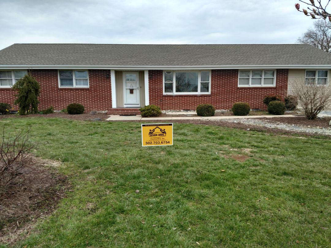 Greenwood, DE - Spicer Bros Construction removed one layer of shingles in Greenwood, DE and installed new GAF Timberline HD shingles Weathered Wood in color.