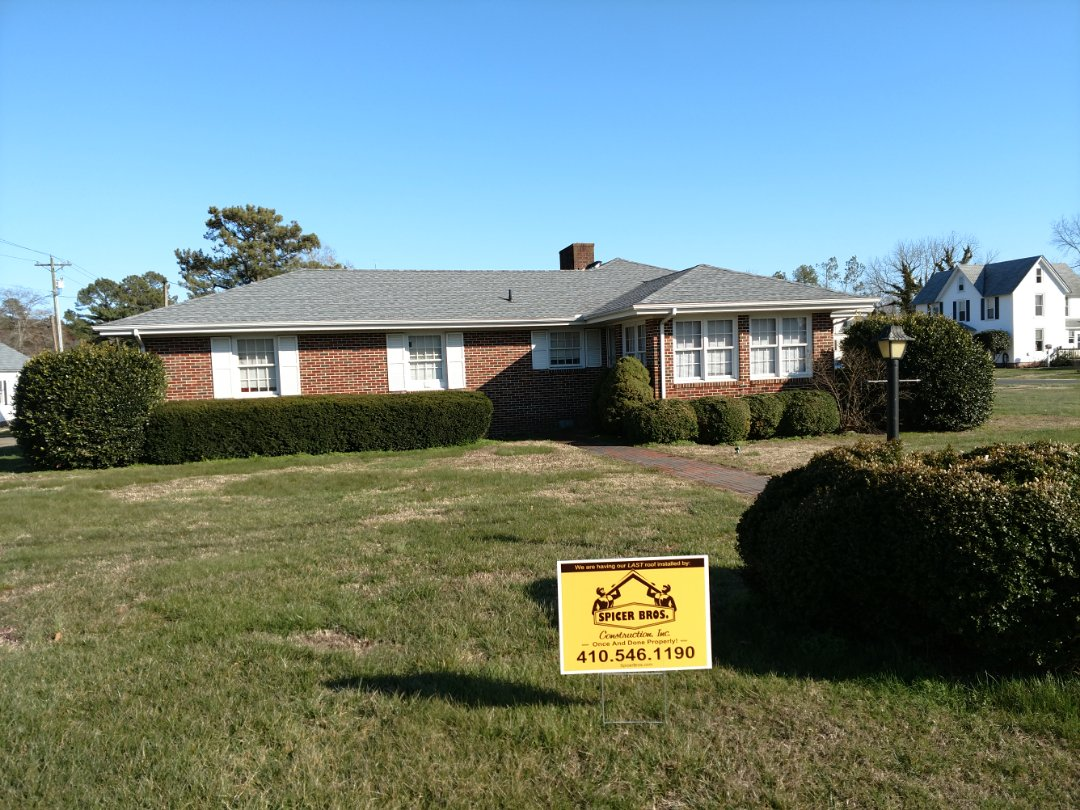 Parksley, VA - Spicer Bros Construction removed multiple layers of shingles in Parksley, VA and installed new GAF Timberline HD shingles Oyster Gray in color.